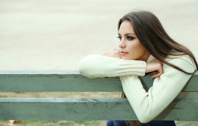 bigstock-young-lonely-woman-on-bench-in-53107465-e1438631854921